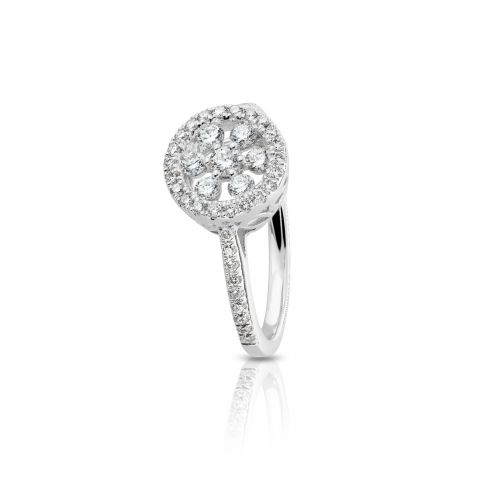 Bague Hulchi Belluni en or blanc, diamants au centre, entourage et sur le corps